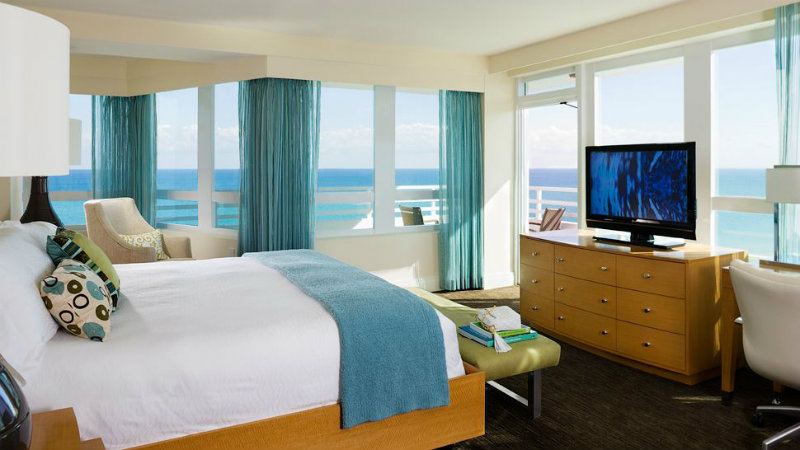 Best Luxury Hotels in Miami: The Iconic Fontainebleau Miami Beach luxury hotels in miami Best Luxury Hotels in Miami: The Iconic Fontainebleau Miami Beach covet edition Best Hotels in Miami Fontainebleau Miami Beach bedroom ocean view balcony