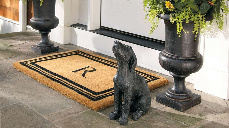 The best 14 luxury decorating ideas for the Holiday Season ➤To see more Coveted articles visit us at http://covetedition.com/ #covetedmagazine #luxuryinteriordesign #luxurylifestyle @CovetedMagazine luxury decorating ideas for holiday season The best 14 luxury decorating ideas for Holiday Season Chic R Letter on Front Door Mats Colored in Brown and Black Placed neat Dog Statue 1